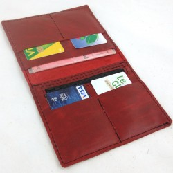 Leather wallet raspberry red coloured, black color sewing