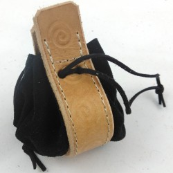 Leather purse black coloured with spiral ginger coloured pattern