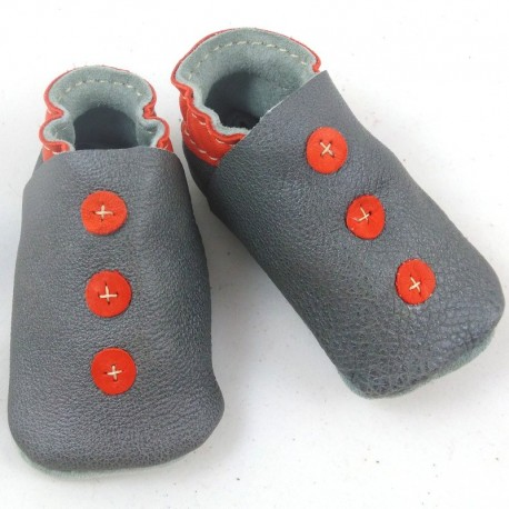 Baby leather slippers grey and orange coloured, button pattern