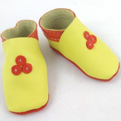 Baby leather slippers yellow and orange coloured