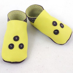 Baby leather slippers yellow and purple coloured
