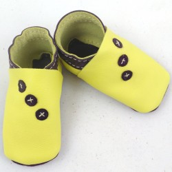 Baby leather slippers yellow and purple coloured with diagonally peas