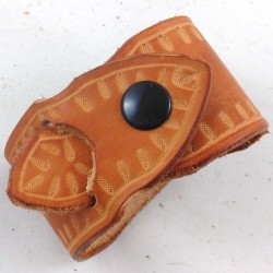 Hammered leather bracelet with grain of wheat pattern