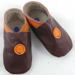 Baby leather slippers chocolate and orange coloured bubble pattern
