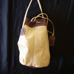 Leather sailor bag, cream and plum coloured