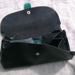 Shoulder clutch bag, in black and green colored leather